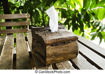 Tissue paper in wooden box on wood table