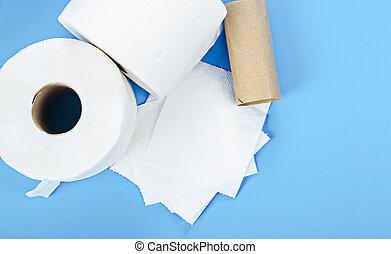 Tissue paper rolls on blue background.