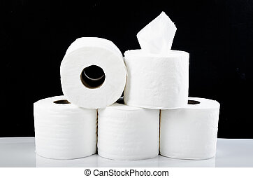 Tissue paper rolls on the black background.