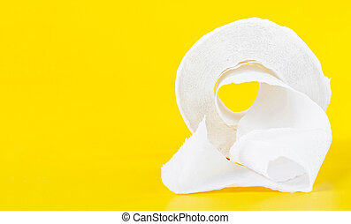 Tissue paper rolls on the yellow background.