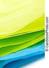 Tissue paper - Close up of blue green and yellow tissue...