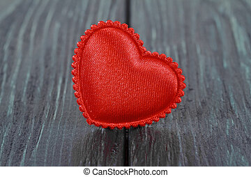 Tissue red heart on a wooden background