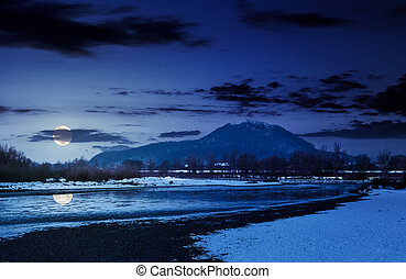Tisza river in winter at night in full moon light....