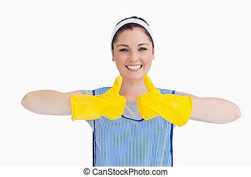 tisztító, nő, feláll, sárga, pár kesztyű, lapozgat