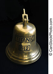 big cooper bell with an inscription Titanic on black background