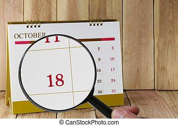 tizennyolcadik, october., konzerv, magasztalás, hónap, naptár, szám, tizennyolc, néz, dátum, kéz, összpontosít, pohár, ön