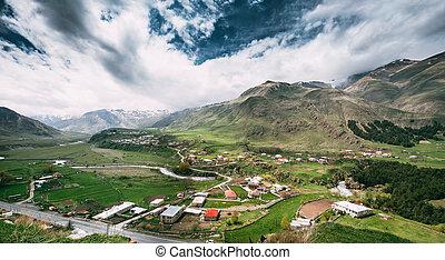 Tkarsheti Village On Mountain Background In Kazbegi District, Mtskheta-Mtianeti Region, Georgia. Panorama