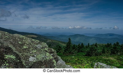 TL Grassy Ridge Monument - A view of a valley in summer from...