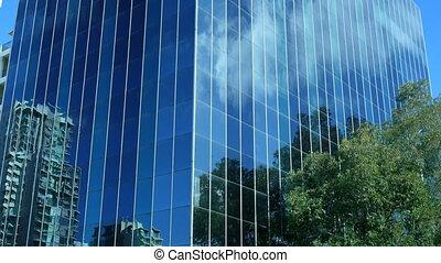Tmelapse skyscraper cloud reflections