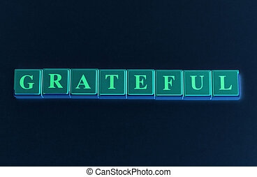 Grateful spelled out in colored blocks