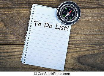 To Do List and compass on wooden table
