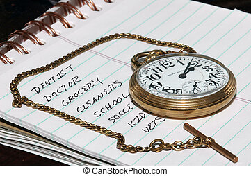 To do list and watch - A pocket watch showing very little...