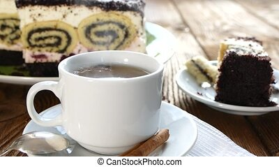 To drink tea with a cake.