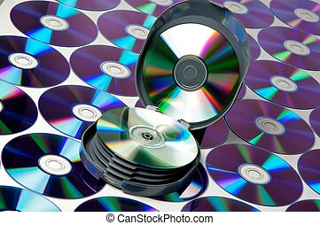 To many CD disks and case on a background for design.