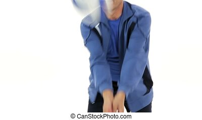 To Play Volleyball - An elderly man in a tracksuit playing...