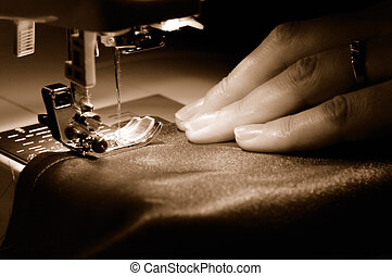 sewing machine - To sew a  material on the sewing machine