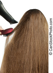 To the girl with long hair stack hairdress. The Rear view. ...