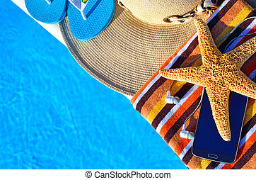 toallas, estrellas de mar, célula, correas, sombrero,...