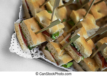 Toast and canapes on a caterer buffet