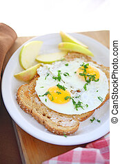 Toast and fried eggs breakfast