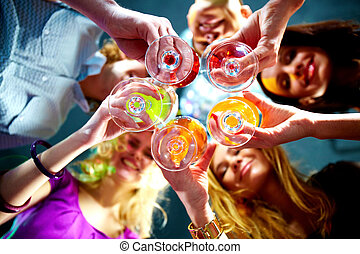 Toast - Below view of people clinking glasses with each...