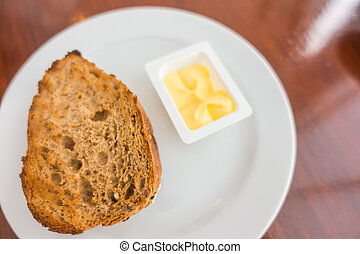 Toast bread on a white plate .