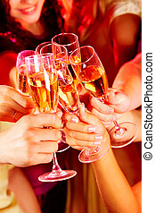 Toast for friendship - Image of friends hands with crystal...