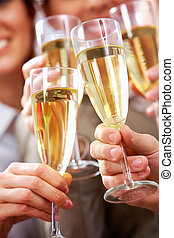 Toast for success - Image of businesspeople hands holding...