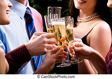 Toast - Image of human hands holding the glasses of...