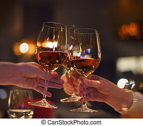 Toast in restaurant with full glasses of rose wine