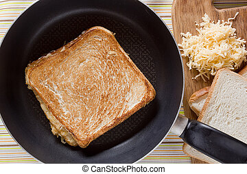 Toast on frying pan on the table with a tablecloth