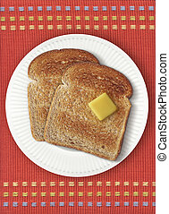 Toast on Orange Placemat - Two slices of toast with butter...
