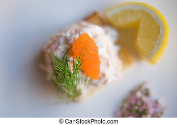 Toast Skagen shrimp sandwich on white table with citrus on the s