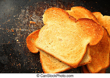 Toast slices on old cookie sheet