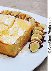 Toast topped with honey and ice-cream , banana