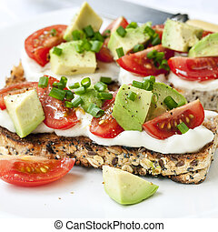 Toast with Avocado Tomatoes and Cream Cheese