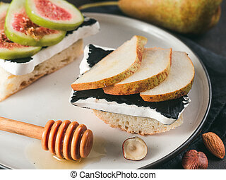 Toast with black camembert cheese and pears