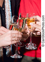 Toast with champagne - Image of human hands holding the...