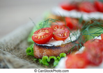 toast with cheese and cherry tomatoes