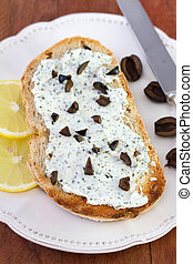 toast with cheese, olives and lemon