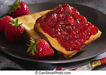 toast snack with cherry jam and strawberry