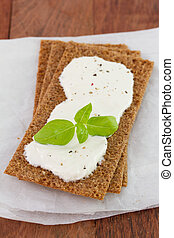 toast with cream cheese and basil