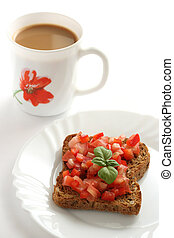 Toast with cut tomato and coffee