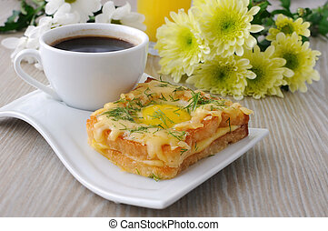 Toast with egg and cheese with dill and a cup of coffee