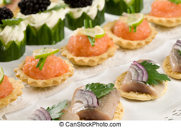 Toast with fish - Small toast with raw herring and salmon