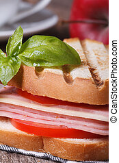 toast with ham, cheese and basil close-up vertical