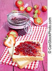 Toast with jam on wood