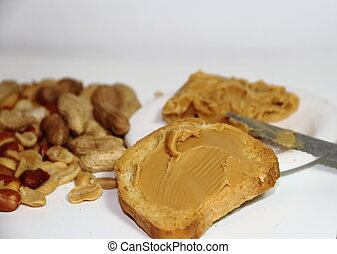 toast with peanut butter on white background