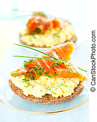 toast with scrambled eggs, salmon and chives
