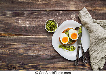 Toast with soft-boiled egg and pesto sauce